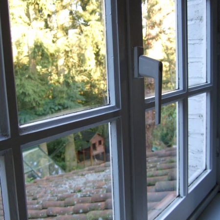 Wooden window with latch