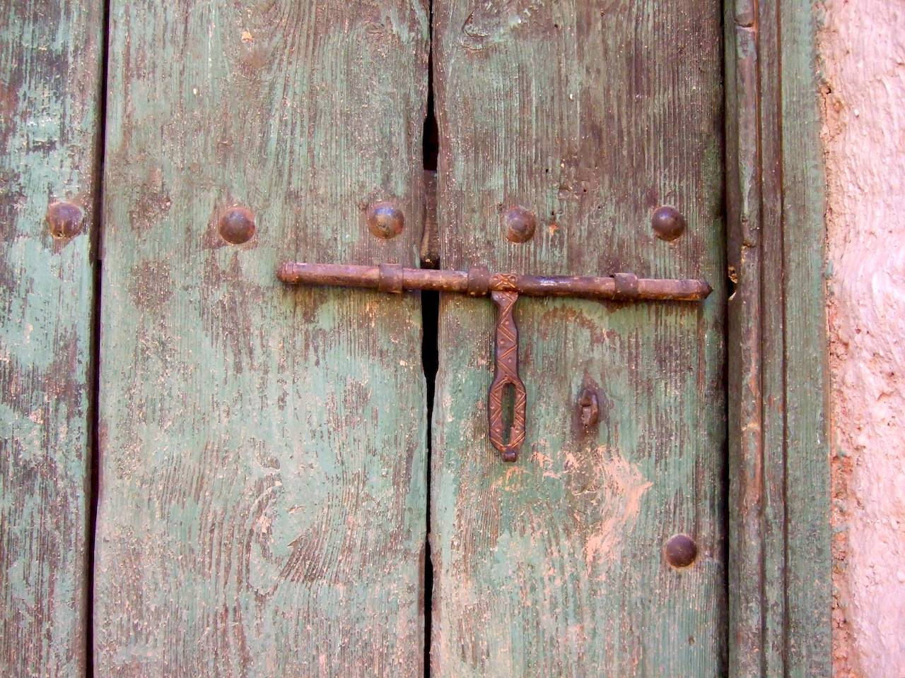 Wooden door with latch hut